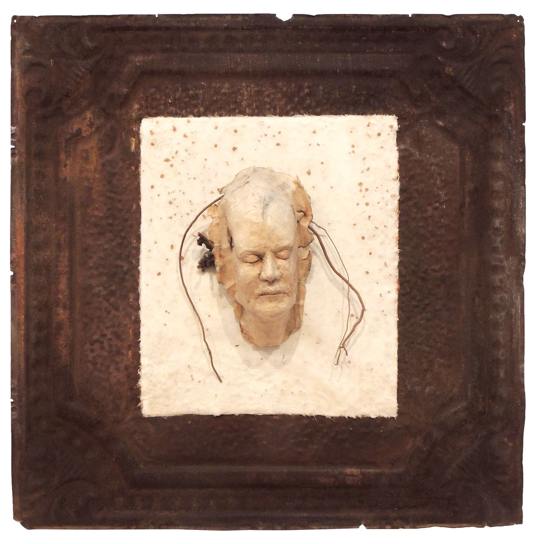 Alice Robrish | ANCESTORS – FACES IN THE WALL II | mixed ceiling tin,handmade paper, paer maché, wood