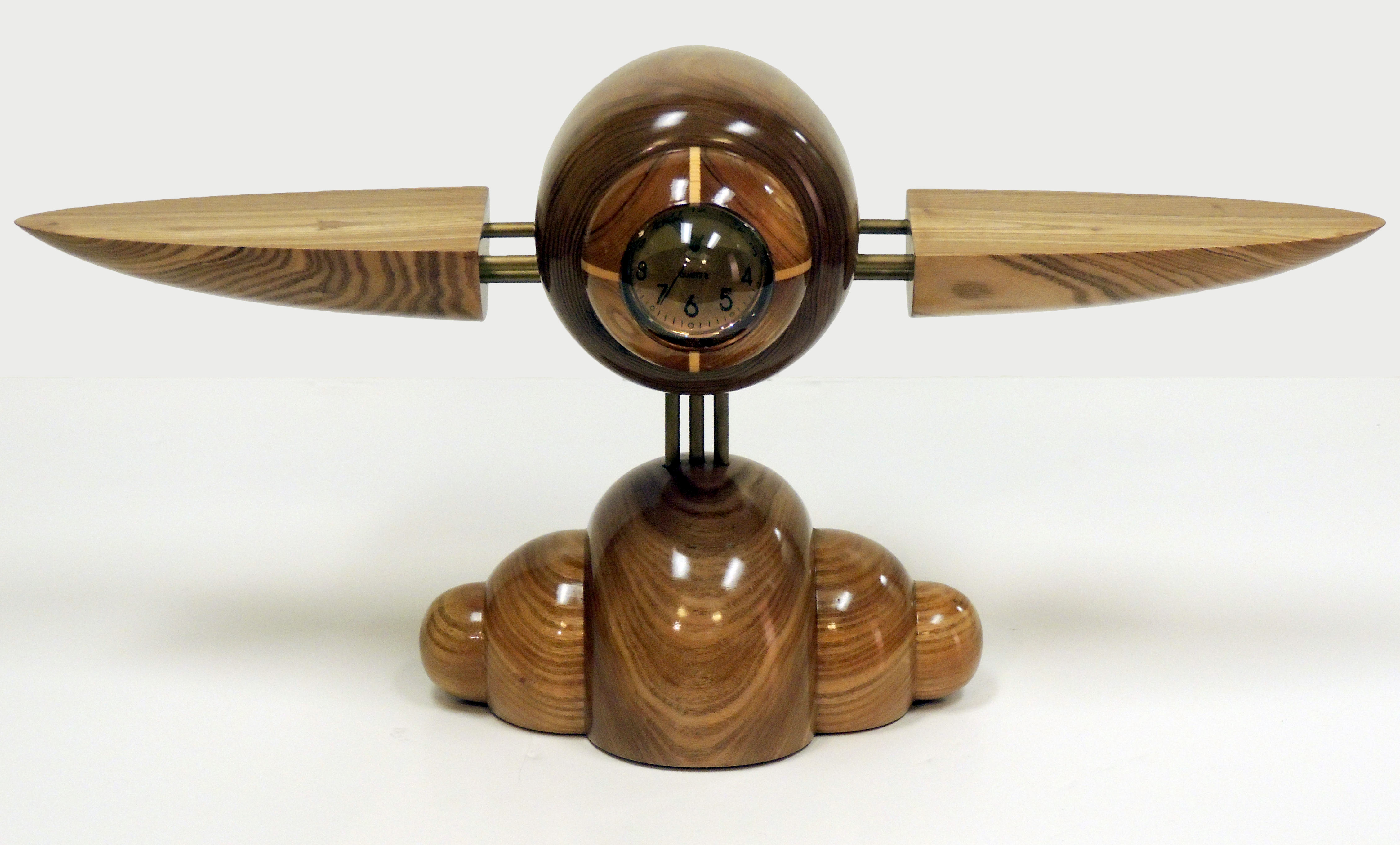 Tom Hawley | TEMPUS VOLARE I | spalt maple, walnut, brass, clear epoxy resin lens, Seiko quartz clock | 16 x 32 x 12"